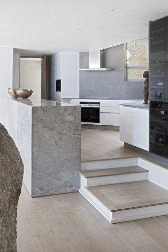 OHKA and Bomax designed the home with a contemporary aesthetic and a respect for traditional craftsmanship