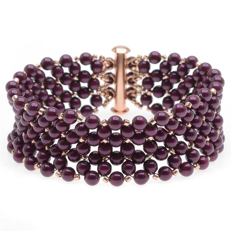 Delicate crystal pearls and seed beads are woven together in this pretty bracelet.  The blackberry pearl color looks so lovely with the gold and rose gold accents.
