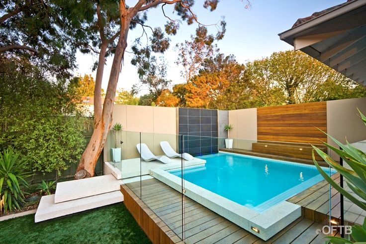 Small Modern Swimming Pool - glass around the exterior to make it child friendly