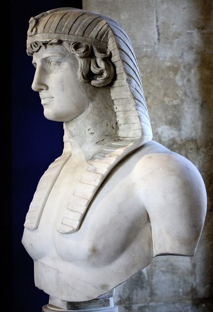 Bust of Antinous, the favorite of Hadrian, in Egyptian royal headdress. Roman, early second century AD, with restorations. Avignon, Musée Calvet, on loan from the Louvre