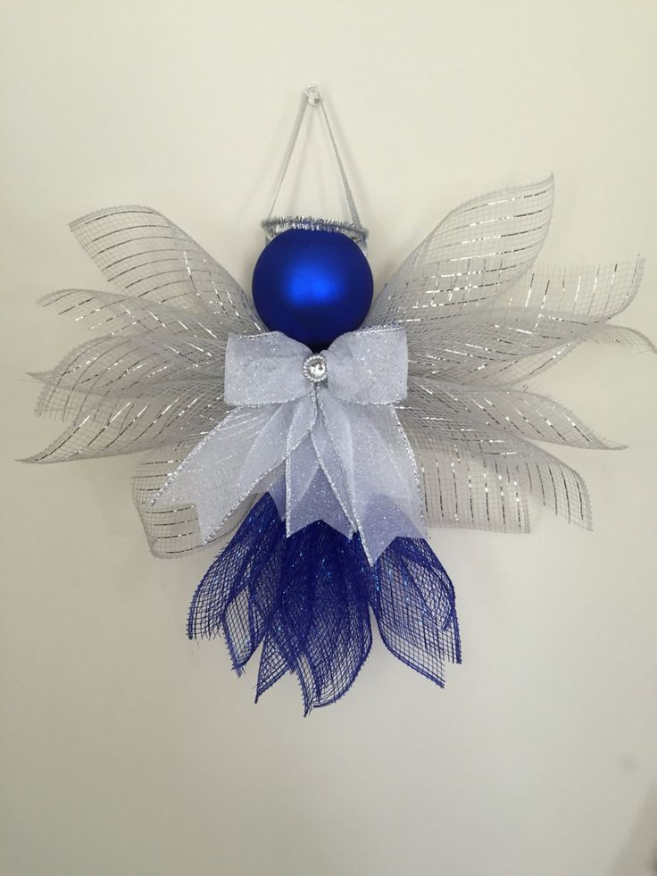 Large Angels made out of Deco mesh and ribbons. Large enough to hang on a wall or door. Great for a gift topper. Approx. 11 inches in height and 13 inches wide. #wide_ribbon_crafts