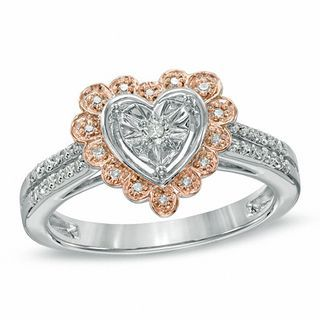 """Nothing says """"I love you"""" like a heart-shaped diamond ring. Fashioned in bright white and soft rose-toned sterling silver, this ring features a single shimmering diamond in a heart-shaped frame at the center. A scalloped border of accent diamonds surrounds this center stone, while additional accent diamonds line the ring's double shank. An amazing gift of love, this ring captivates with 1/5 ct. t.w. of diamonds and a bright polished shine.  This ring is available in..."""
