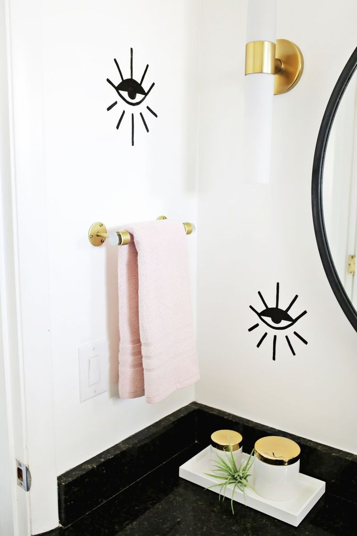 Make the easiest ever lucite hand towel rack for your bathroom