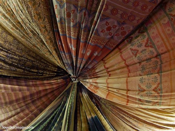 Imagine a fabric draped ceiling and walls in the attic reading nook. Something to soften the space and make it feel like a cozy cocoon of relaxation ... maybe with lights behind for a slight glow.