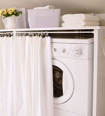 Like idea of putting fabric curtain in front of laundry appliances. Can add color/texture and hide them!