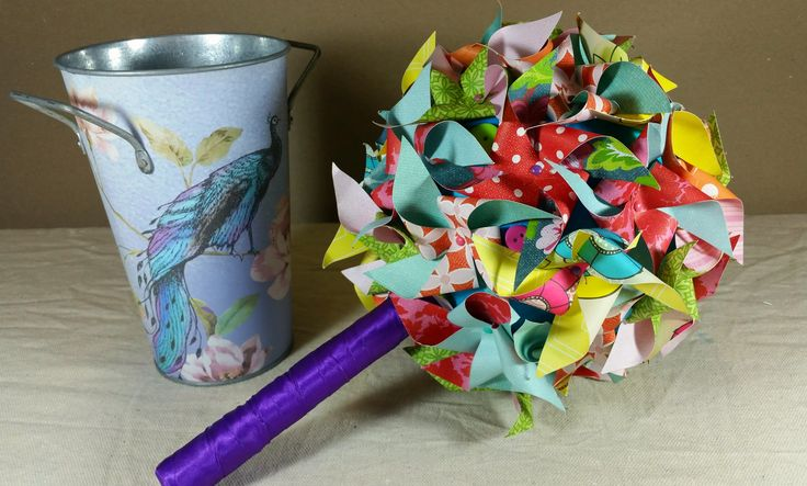Bright pinwheel bouquet with buttons. Made from paper for something different and everlasting. Made by Bouquets and Beyond