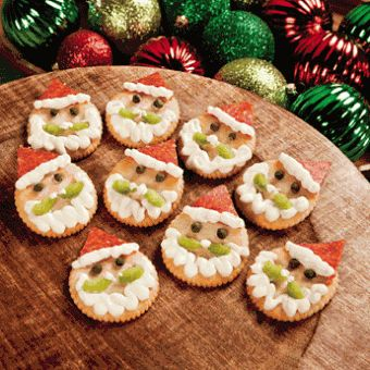 Santa Crackers - Round crackers, pepperoni, ricotta (or cream?) cheese, capers, celery