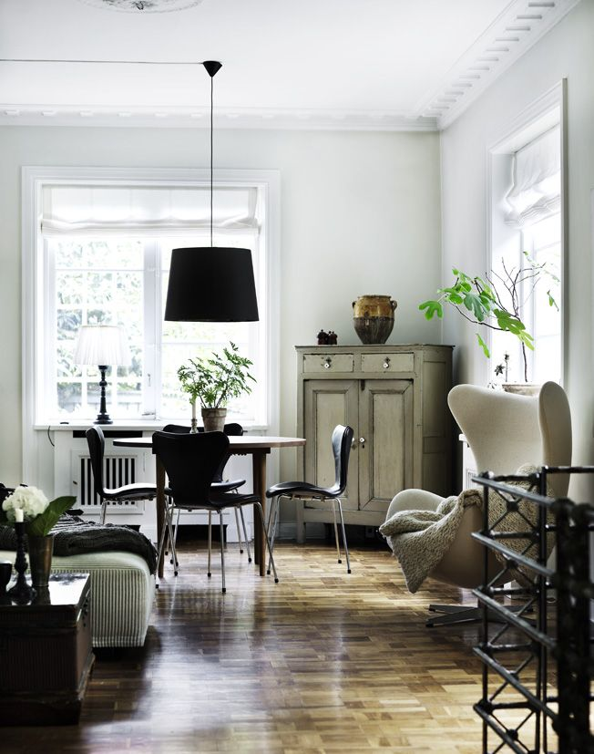 Danish living room: a great combination of a restrained palette with nice textures and a mix of styles, where no single piece dominates the rest.