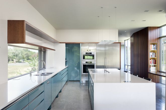 "Modern kitchens - definitions of ""modern"" vary widely, but when you think of modern kitchen designs it's often with frameless cabinets, sleek and simple hardware, strong horizontal lines and a lack of ornamentation, with the natural beauty of the materials shining through."