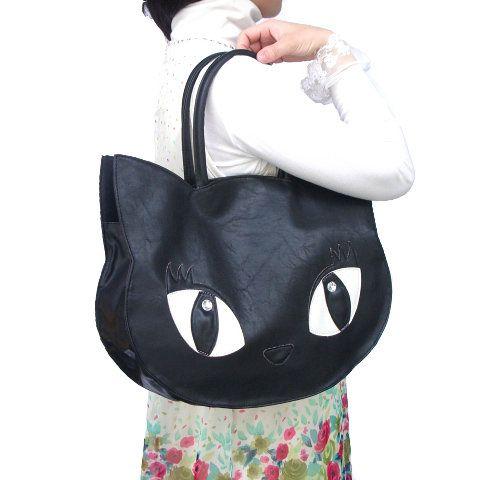 Bolsos con forma de gato realizados en tela de peluche. Su gran tamaño es ideal para llevar varios libros o carpetas y algunos accesorios.