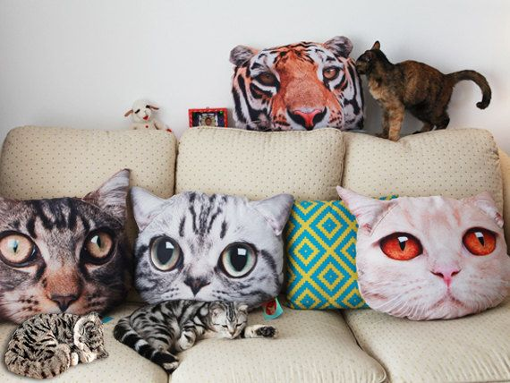 A large set of cat-face pillows for any feline-friendly apartment. | 15 Of The Cheesiest Gifts To Give A Cat Lover