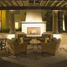 This outdoor lounge at The Village at Irvine Spectrum Center is perfect for a nice, relaxing evening with friends. #lovewhereyoulive #Irvine #apartments #outdoor #lounge #fireplace #comfy #relaxing