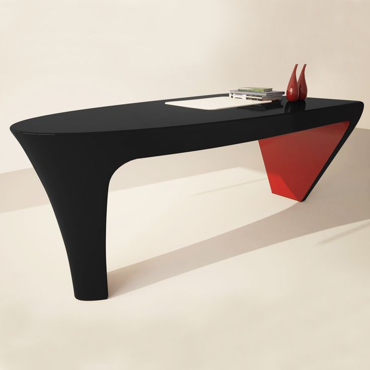 A desk design with minimalist lines and elegant, modern and avant-garde forms.  In the structure resembles a heel shoe for women, an office desk practical and functional, despite the strong image and the impact of design.       The design of the desks and all the other elements that make up the executive office is more modern and innovative, able to impress in every circumstance.     Outside LACQUER FINISH GLOSS, internal MATT LACQUER FINISH