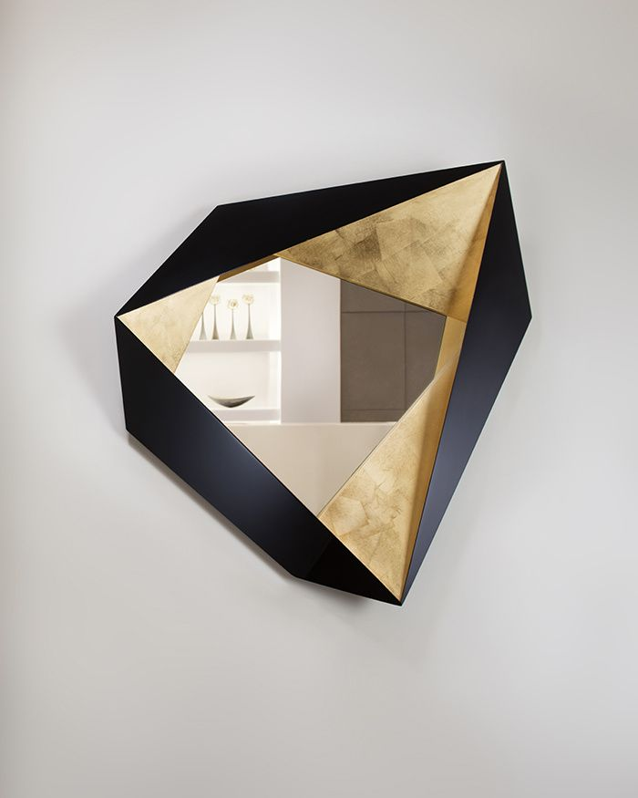 FUTURISTIC WALL MIRROR WITH GOLDEN DETAILS | An extraordinary piece of art for any bold living room decor or entrance | www.bocadolobo.com #wallmirror