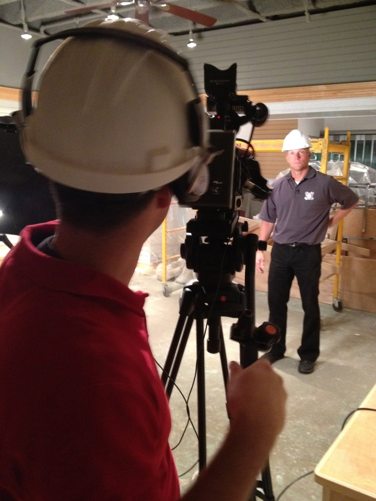 on location during construction of the renovated Centrium with Cam Moon, voice of the Red Deer Rebels.