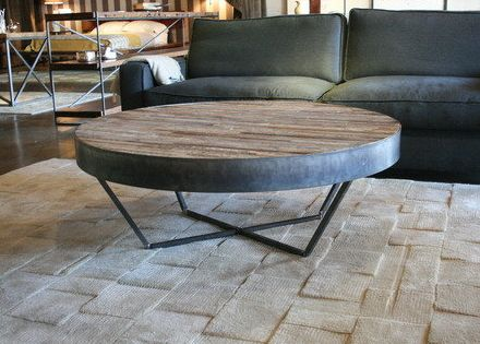 Patchwork Coffee Table - This handmade round coffee table is constructed from reclaimed wood salvaged from an old Alabama whiskey factory. The piece is a handsome marriage of  modern and rustic styles – with the gray patchwork pattern of reclaimed wood mounted on a strong, contemporary iron base.  Croft House