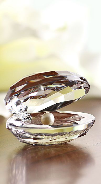 Swarovski aquatic shell with pearl inside.  Show me in pearls... (www.crystalclassics.com)