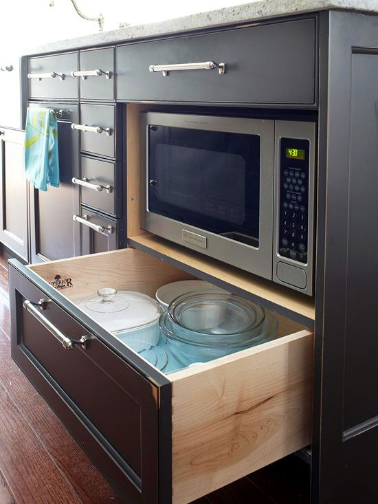 Despite its narrow construction, the island packs in plenty of storage options. Deep drawers offer storage space for larger items such as pots and pans, while others provide the perfect spot to stow away hand towels and utensils. An open shelf on one side of the island creates a handy spot to place a microwave.