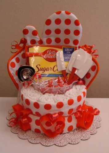 Kitchen Towel Cake.... Dollar Tree has the Betty Crocker kitchen tools right now. Super cheap gift idea!