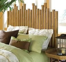 This bed uses different lengths of bamboo stalks - and for those of us that don't happen to have bamboo growing in our backyard (which I would imagine is most of us)...the same effect can be achieved with using any sort of logs of different lengths.