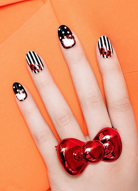 This nail wrap beauty collaboration is a combination of two of our favorite things: Hello Kitty and eye-catching nail art. All you need to do is brush some clear polish onto your nails as a base, apply the individual wraps to each finger, file and daub on topcoat!