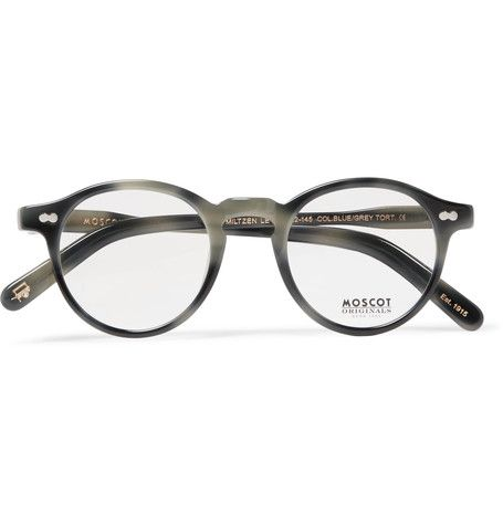 These acetate sunglasses by Moscot exemplify the Manhattan optical brand's aptitude for modern reworks of heritage styles. The classic round frames are finished with discreet copper designer plaques on the insides of the arms.