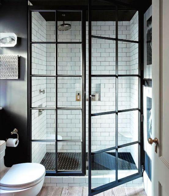 Shower doors in black and white bathroom