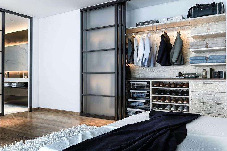 This reach-in closet uses an Asian flare with roll-back doors and clean lines.