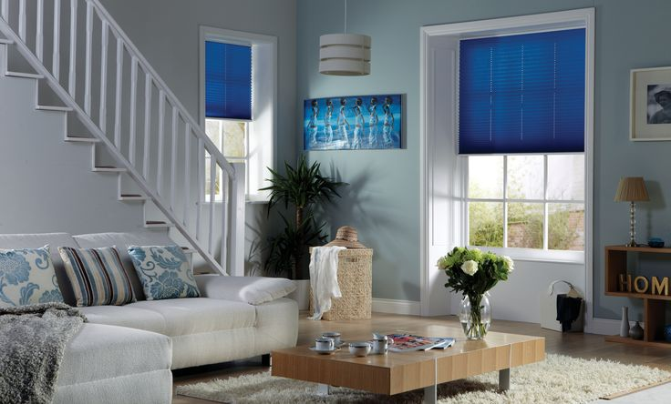 Blue Pleated Blinds add a pop of colour to this living room