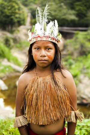 Yagua girl, in the Amazon jungle of Peru.  Tribe photo + traditional tribal dress.  By travel photographer, portrait photographer and humanitarian photographer, Alicia Fox (Sydney, Australia).