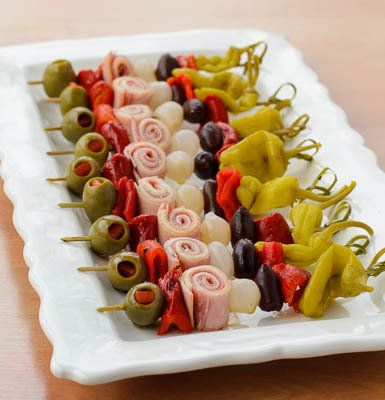 Muffuletta Skewers...olives, peppers, meat and cheese all on a stick. Oh yea!
