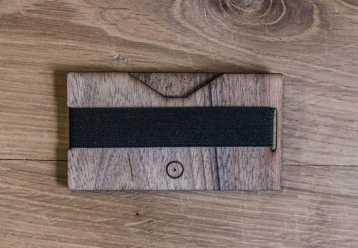 http://poppy.lt/product/handmade-wooden-card-holder-black/