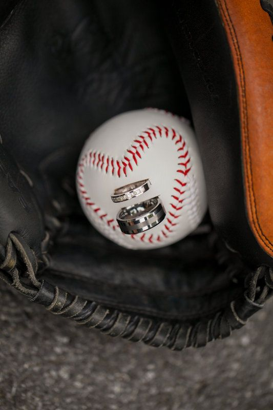 Usher carried our wedding bands down in a catchers mit. My husband loves baseball!