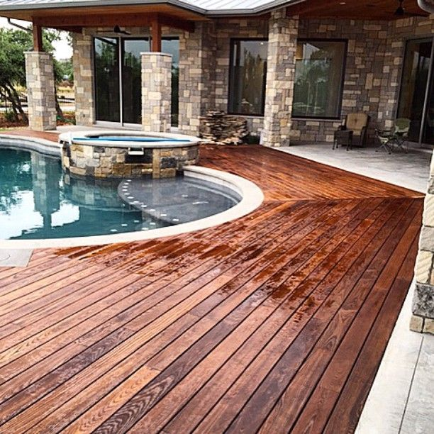 Thermally modified wood never looked better! This residential Arborwood decking was installed by AweStruct Construction in Austin, Texas.