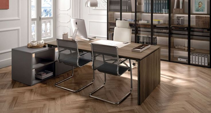 Z692 - Executive table with Crono chair and Calla chairs. Link System bookcase with Teca glass doors.