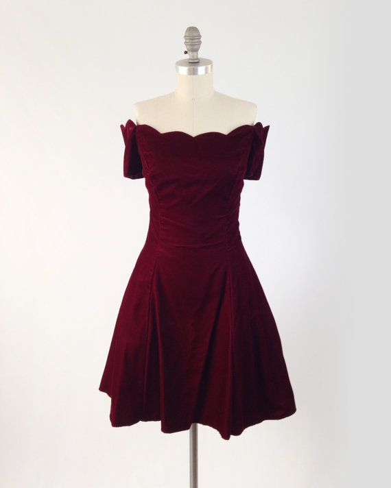 Fit and Flare Prom Dress from the late 1980s !  Features a scalloped neckline, princess seams, and off the shoulder sleeves. Made of a deep red