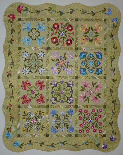 Loretta Ockwell - download patterns at Piece O Cake. Love the appliqu and the wavy edged border.