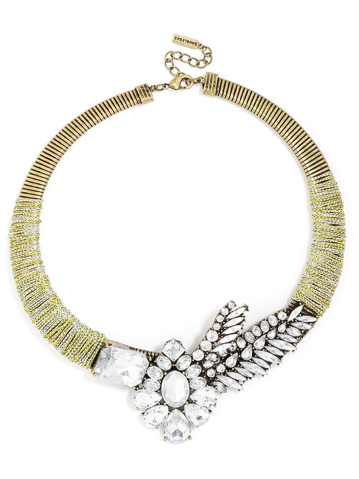An asymmetrical gem-embellished masterpiece crowns this metal collar wrapped in contrasting thread. The botanical motif gives the piece personality--an all-star piece for your fall wardrobe.