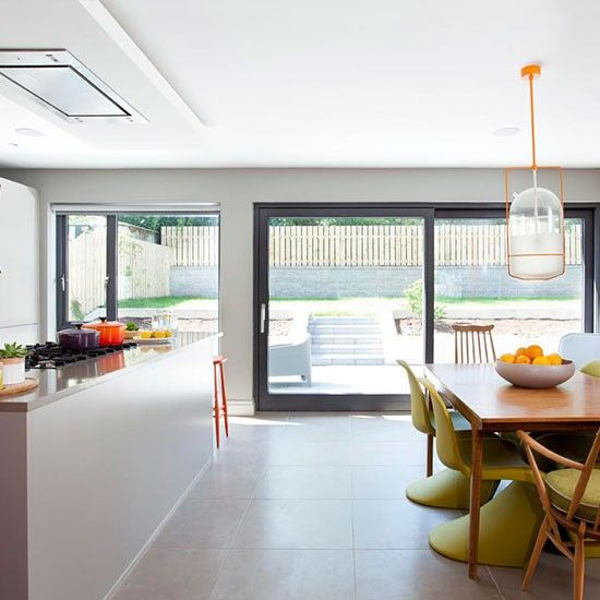 Modern open-plan kitchen with orange accents | Decorating