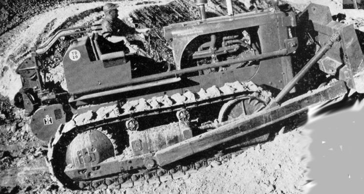This shot does give a good view of the general layout of an International TD-20. Equipped with a Superior double drum cable control and Bucyrus-Erie straight blade, the machine is seen stockpiling fill. Photo is dated 1958 which would make this a TD-20 200 series machine