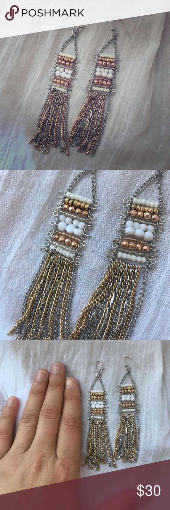 Stella & Dot Tassel Drop earrings Stella & Dot never been worn- great going out earrings or everyday work! The mixed silver bronze and gold make these extremely versatile! Stella & Dot Jewelry Earrings