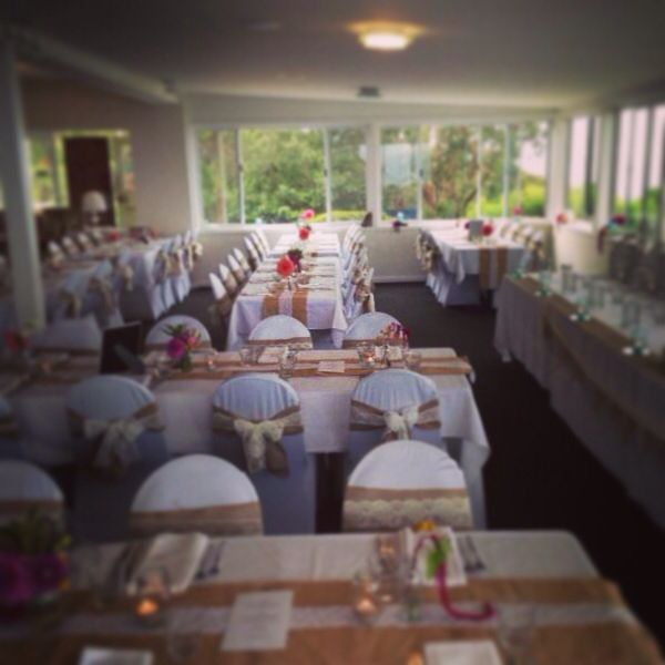 Burlap lace chair sashes and table runners at this wedding. Styling and florals by Owl + Pussycat events