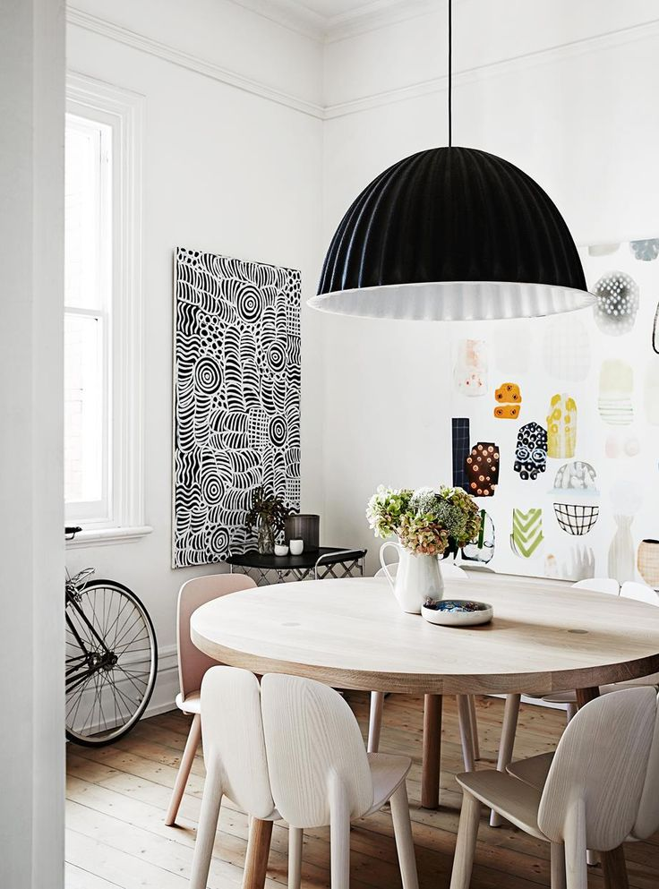 """Dining room walls were painted in Dulux """"Lexicon"""" quarter strength and floors were stripped back. Interest was added with an artwork by Fred Fowler and Muuto pendant."""