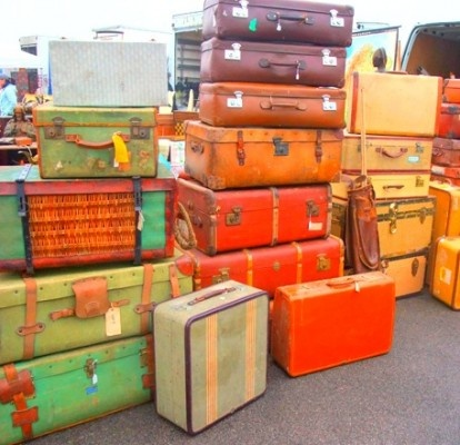 Stack of multi coloured suitcases vintage orange red green Repinned by www.silver-and-grey.com