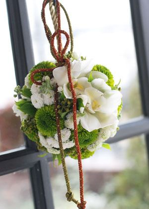 Japanese style bouquet, looks suspiciously like a pomander.