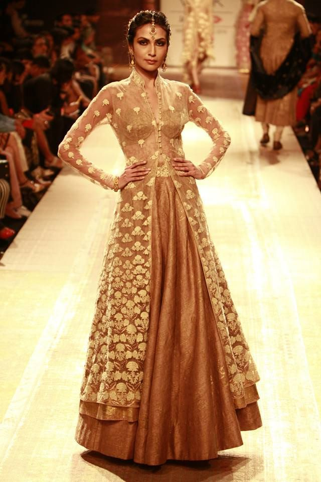Cream and gold jacket lehenga. Fabulous choice for an Indian Christian bridal outfit.