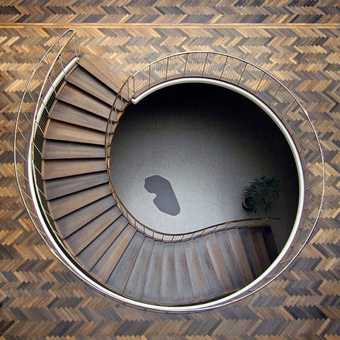 Arhus City Hall by architect and designer favorite, Arne Jacobsen, combines graphic herringbone pattern with an organic nautilus shell staircase- just lovely!
