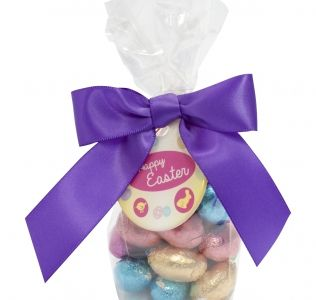 Promotional gift bag filled with foil wrapped mini chocolate Easter eggs
