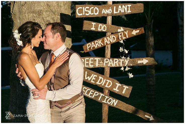 """What a great """"direction board"""" idea to have at the entrance of your wedding.  This Rustic wedding was one of my favourites of the past year Wedding photos taken at Molenvliet Wine Estate in Stellenbosch.  Couple having fun while walking along farm road.  See more of this wedding on our blog http://www.zara-zoo.com/blog/fresh-wedding-ideas-molenvliet/"""