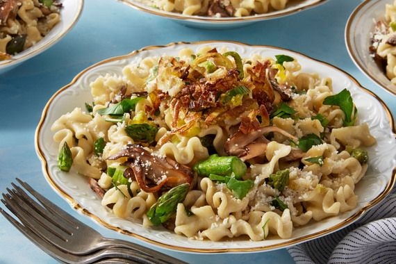 Creamy Mafalda Pasta with Asparagus, Mushrooms, & Crispy Leek.